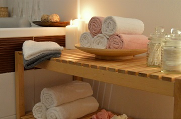 Bathroom reconstruction wooden shelf with towels