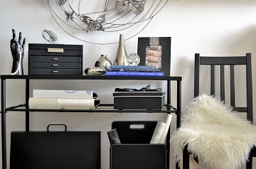 Lady`s bedroom black console with decorations