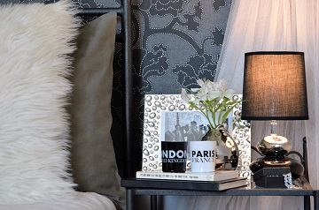Lady`s bedroom pillows and nightstand