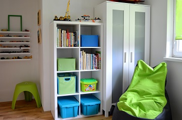Boy`s room reconstruction white furniture and green blue decorations